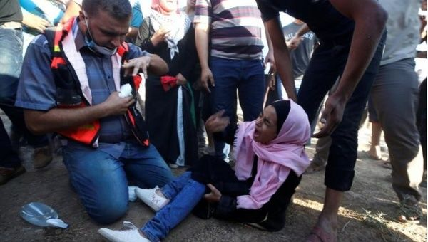 Medics said Israeli gunfire killed two men and wounded at least 270 other Palestinians, 40 of them with live bullets.