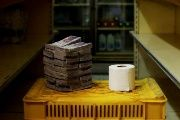 A toilet roll next to 2,600,000 bolivars, its price and the equivalent of US$0.40 at a mini-market in Caracas.