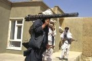 Taliban fighters in south Afghanistan pose with weapons.