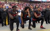 San Francisco 49ers outside linebacker Harold, quarterback Kaepernick and free safety Reid kneel in protest during the playing of the national anthem in 2016.