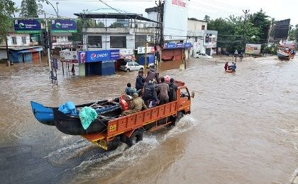 A supply truck transporting boats to flooded areas moves through a water-logged road in Aluva in the southern state of Kerala, India, August 18, 2018.