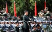 Chinese President Xi Jinping inspects troops at the People
