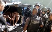 Brazilian Army soldiers arrest young men in Alemao slums complex in Rio de Janeiro, Brazil August 20, 2018