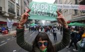 "Abortion rights activists holds a sign during a gathering as lawmakers are expected to vote on a bill legalizing abortion, in Buenos Aires, Argentina August 8, 2018. The sign reads ""Legal abortion now."""