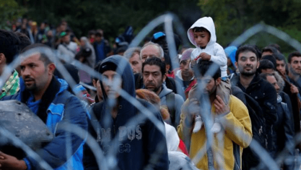 Migrants after crossing the border at Zakany, Hungary, October 16, 2015.
