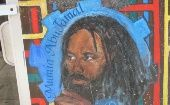 A mural depicting imprisoned Black Panther Party member Mumia Abu-Jamal.