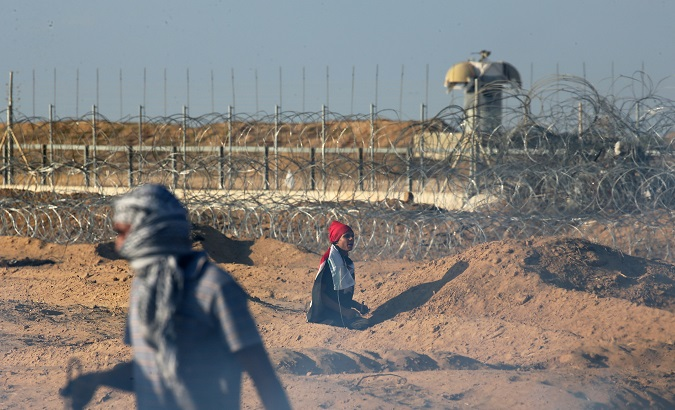 Palestinians in Gaza take part in Friday's protests near the Israeli fence demanding their right to return as refugees.