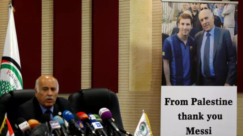 A poster of Palestinian FA chief Jibril Rajoub with Argentina's soccer player Lionel Messi, in Ramallah in the occupied West Bank June 6, 2018.