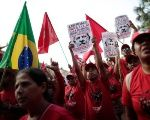 Supporters of imprisoned former Brazil's President Luis Inacio Lula da Silva attend a march before his Workers' Party (PT) officially registers his presidential candidacy, in Brasilia, Brazil, August 15, 2018.