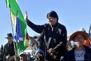 Bolivia's President Evo Morales waves while riding a horse as he arrives at Padcoyo, Chuquisaca, Bolivia, Aug. 23, 2018.