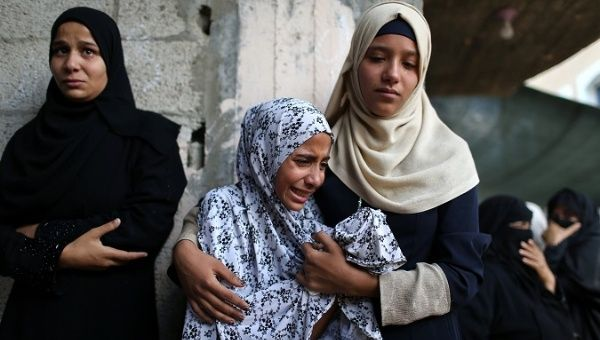 Relatives of Palestinian Sadi Muamar, who was killed by Israeli troops during a protest at the Israel-Gaza border, mourn during his funeral in the southern Gaza Strip.