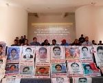 Relatives of the 43 students of Ayotzinapa hold a news conference in Mexico City, March 16, 2018.