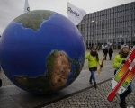 Protesters demonstrate during a rally held the day before the start of the Paris Climate Change Summit in Berlin, Germany, November 29,