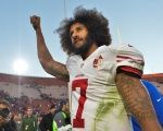 San Francisco 49ers quarterback Colin Kaepernick pumps his fist as he acknowledges the cheers at Los Angeles Memorial Coliseum in Los Angeles, California, U.S. on December 24, 2016.