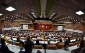 Cuban lawmakers attend a parliamentary session at the country
