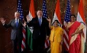 U.S. officials Mike Pompeo and James Mattis pose beside Indian officials Sushma Swaraj and Nirmala Sitharaman before their New Delhi meeting, Sept. 6, 2018.