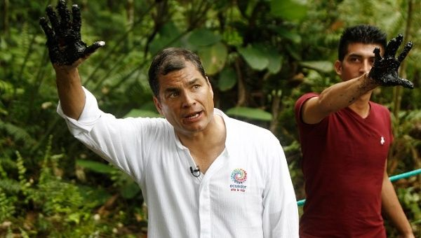 Former president Rafael Correa visits areas contaminated by Chevron-Texaco.