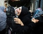 A relative of Belal Khafaja, who was killed by Israeli forces, mourns during his funeral in Rafah in the southern Gaza Strip Sept. 8, 2018.