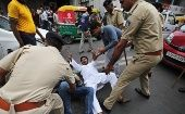 Police detain a protester during the nationwide strike against rising fuel prices in Ahmedabad, Gujarat.