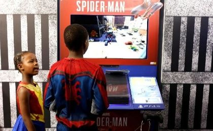 On Friday, costumed patrons played video games and shopped for merchandise in a convention center north of Johannesburg.