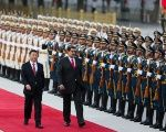 Chinese President Xi Jinping walks next to Venezuela's President Nicolas Maduro during his welcoming ceremony in Beijing, China Friday.