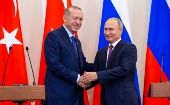 Russian President Vladimir Putin and his Turkish counterpart Tayyip Erdogan shake hands during a news conference in Sochi, Russia Sept. 17, 2018.