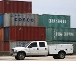 A truck drives past Cosco and China Shipping shipping containers in the Port of Miami in Miami, Florida, U.S., May 19, 2016.