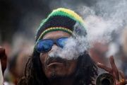 A man smokes marijuana, known locally as dagga, during a march calling for the legalization of cannabis in Cape Town, South Africa, May 6, 2017.