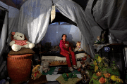 Maria Guadalupe Padilla rests in her tent in the Tlalpan neighborhood.