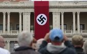A Nazi swastika banner hangs on the facade of the Prefecture Palace in Nice which is being used as part of a movie set during the filming of a WWII film in the old city of Nice, France.
