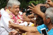 Andres Manuel Lopez Obrador (AMLO) shakes hands with supporters in Sept. 19 visit to Oaxaca.