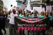 People participate in a protest march for survivors of sexual assault and their supporters in Hollywood, Los Angeles, California, Nov. 12, 2017.
