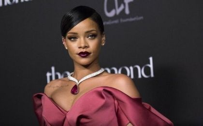 Singer Rihanna poses at the First Annual Diamond Ball fundraising event at The Vineyard in Beverly Hills, California Dec.11, 2014.