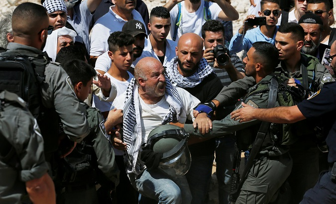 Palestinian man scuffles with Israeli troops in protest against Israel's plan to demolish the Palestinian Bedouin village of Khan al-Ahmar, in the occupied West Bank.