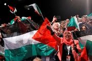 Delegates in the audience wave Palestinian flags and banners at the annual Labour Party Conference in Liverpool, Britain, Sept. 25, 2018.