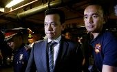 Philippine Senator Antonio Trillanes is escorted by policemen at police headquarters in Makati City, Metro Manila, in Philippines, September 25, 2018.