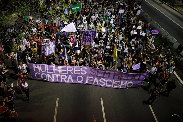 "The writing on the banner reads ""Fearless women against fascism"" in Sao Paulo."