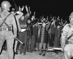 Protesters threatened by Mexican state forces on Oct. 2, 1968.