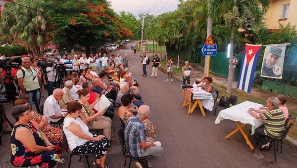 Cubans participate in a debate to discuss the text of the proposed new constitution to vote on in a referendum next year.