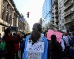 "A protester with an Argentine flag reading ""No to the IMF adjustment measures - Macri, enough!""  outside the Congress in Buenos Aires, Argentina Oct. 3, 2018"