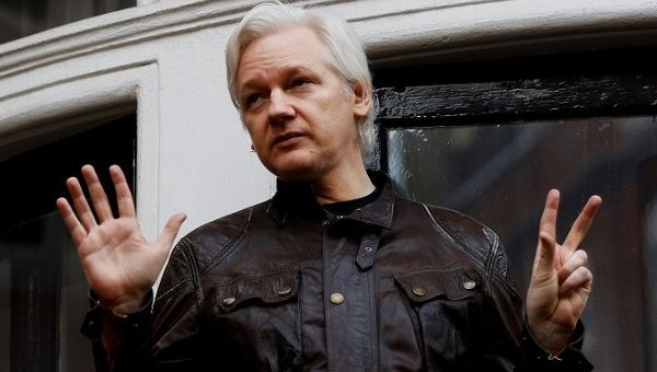 WikiLeaks founder Julian Assange is seen on the balcony of the Ecuadorean Embassy in London.