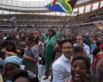 A woman flies a South African flag during the