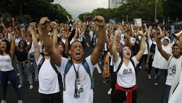 Colombian students take to the streets to demand financial resources for public universities.