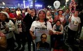 People watch the canonization ceremony for late Archbishop of San Salvador Oscar Arnulfo Romero at the Gerardo Barrios Square in El Salvador, Oct. 14, 2018.