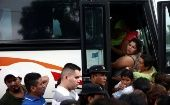 A caravan with Honduran migrants, trying to reach the United States, reenter a bus after a police check.