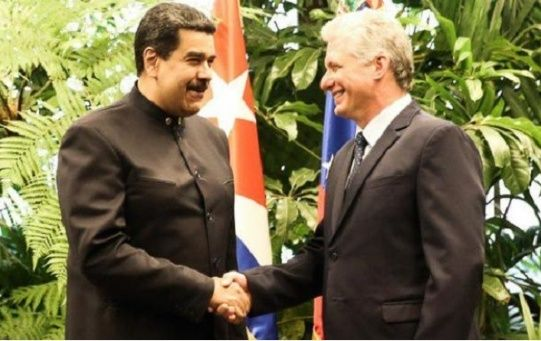 Venezuelan President Nicolas Maduro and Cuban leader Miguel Diaz-Canel share an embrace.