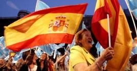 Demonstrators holding the Spanish flag.