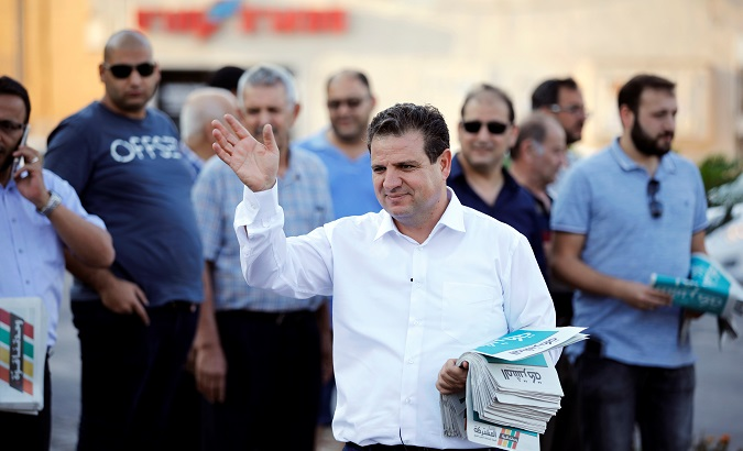 Ayman Odeh, leader of the Joint List, gestures as he hands out pamphlets during an an election campaign event in Tira, northern Israel Sept. 5, 2019.