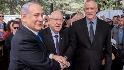 Israeli Prime Minister Benjamin Netanyahu left, President Reuven Rivlin and Benny Gantz, right, leader of Blue and White party, attend a ceremony for late Israeli president Shimon Peres, at Mount Herzl in Jerusalem on Sept 19.