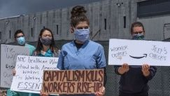 People protest working conditions outside an Amazon fulfillment center warehouse on May 1, 2020, in the Staten Island borough of New York City.